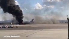 Dramatic moment passengers escape from flaming BA plane.mp4